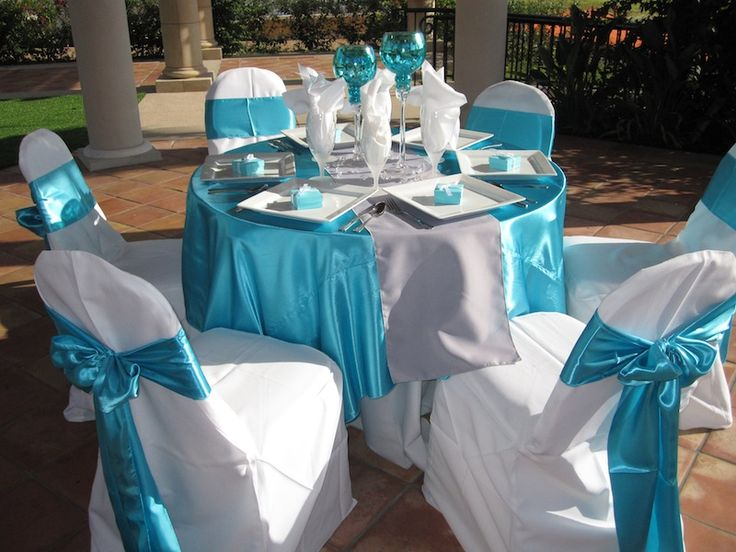 Attractive White Table Cloths With Blue Overlays And Bows On Chairs | White Table Cloth  With Tiffany