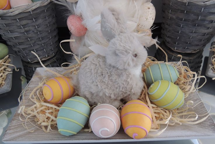 Easter Fluffy Bunny with decorative easter eggs on cement timber look tray