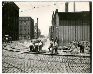 Men working on streetcar tracks. Ninth and Market. Circa 1920-1930.