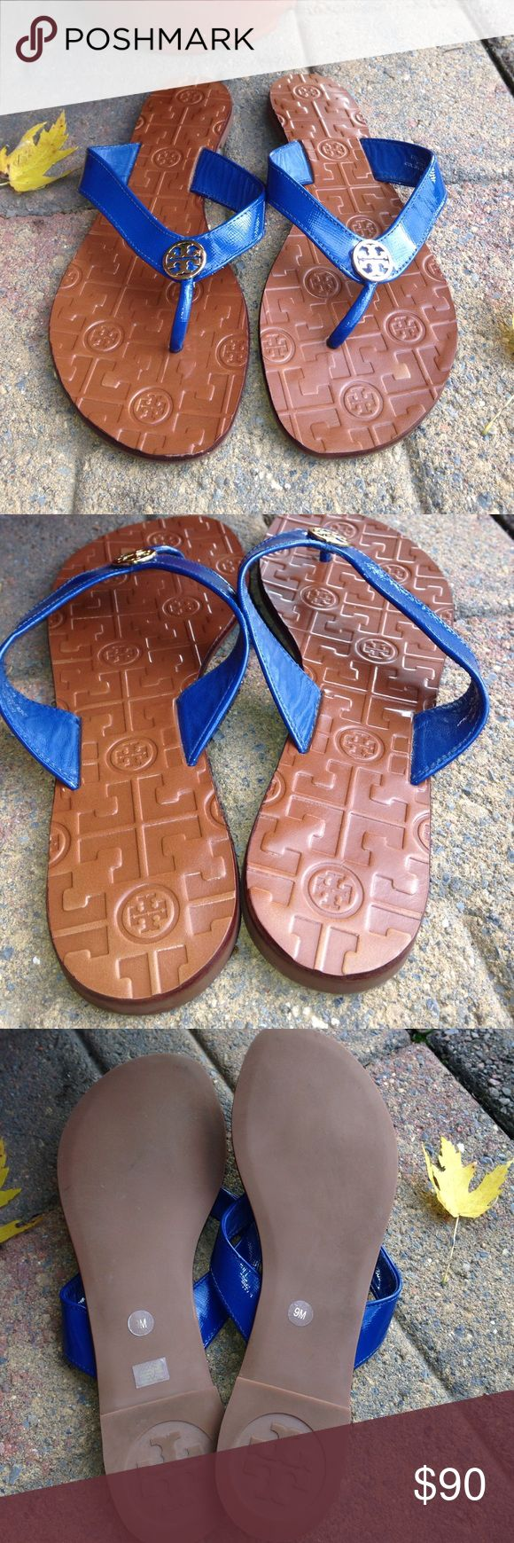 Tory  Burch Sandals Pre  owned used once tags as you can see still on them. Were too tight!!!  These are Tori Thora  sandal flip flop Blue. Beautiful gold T logo!!  Size 9 M. Leather upper and lining. Man made sole. Made in Dominican Republic.  Beautiful condition but they were worn once!!! Tory Burch Shoes Sandals