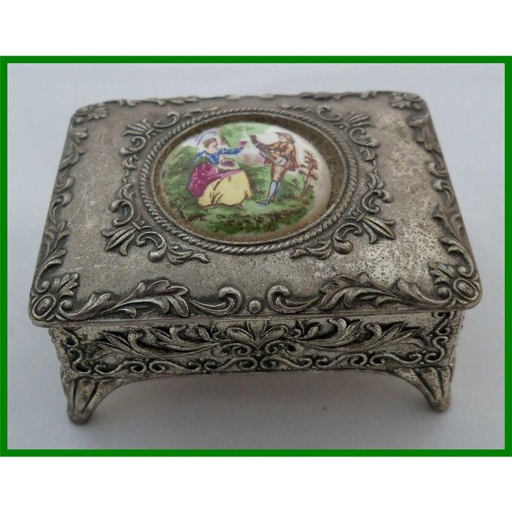 Ornate metal trinket box with ceramic plaque