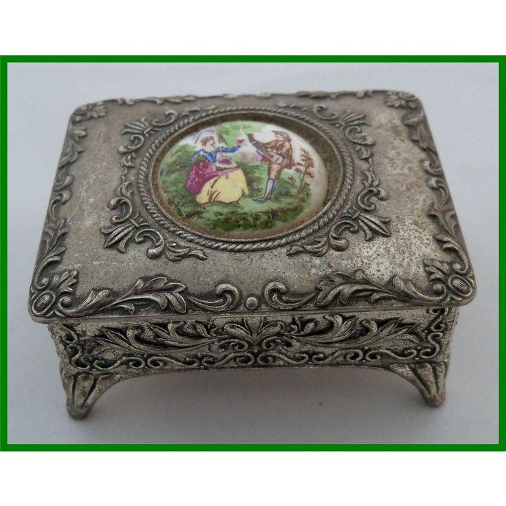 Ornate metal trinket box with ceramic plaque