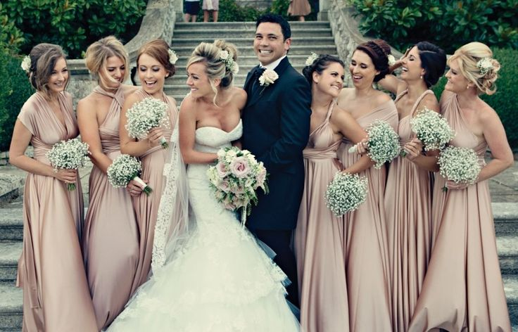 I like the girl on the far lefts dress, abit more pink that rose gold though but the colour would fit your theme still - Shannon