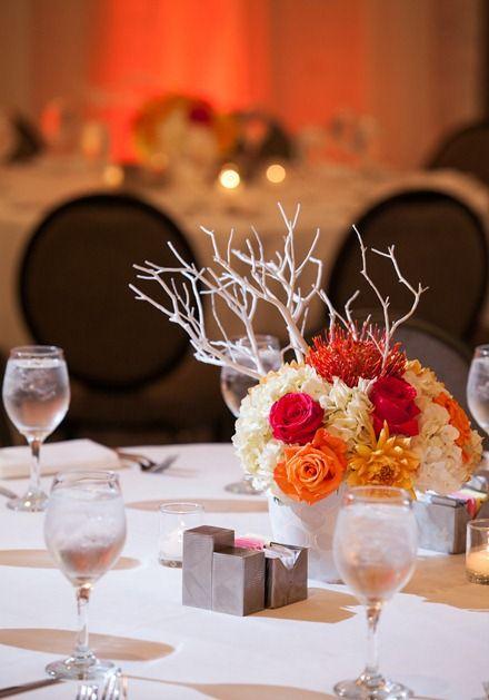 Pink and orange wedding centerpieces.