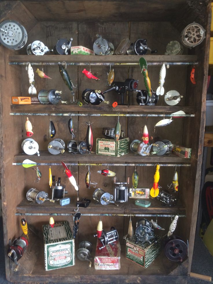 Display for fishing reels and lures. Made from an old crate.