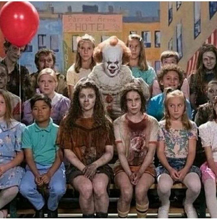 Pennywise with the missing kids on TV