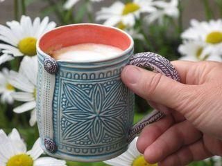 Hand-built textured mug...check out the cute clay buttons. - Artist Jan Stackhouse.