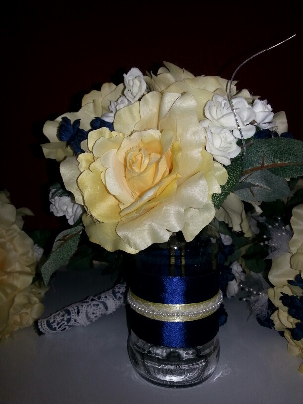 Navy blue and yellow centerpieces my brother is getting
