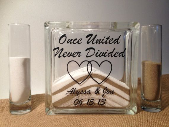 You said if you did sand you wouldn't want a plain container, something like this would be cute. But we could always DIY it!   Unity Sand Wedding Ceremony Set by TheDreamWeddingShop on Etsy, $37.95