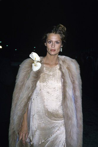 Lauren Hutton in a Fortuny sleeveless Delphos and silk belt, photographed by Barry Lategan, c. 1970s