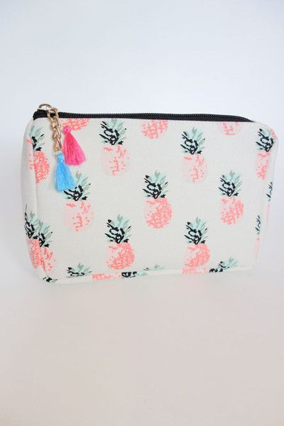 A piece perfect for housing all the things you need to create all your foxy looks, this makeup bag is covered in a print of pineapples. It features a super adorable pink and blue tasseled zip-top clos