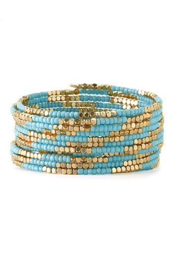 Free shipping and returns on Cara Accessories Beaded Coil Bracelet at Nordstrom.com. Tiny seed beads create a two-tone effect on a stylish coil bracelet.