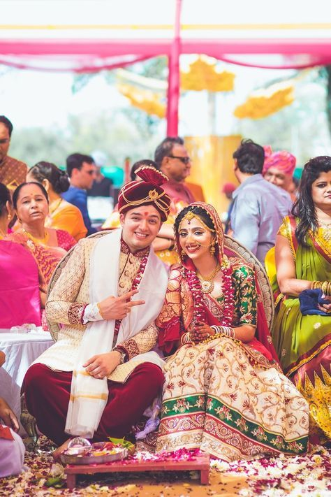 Bride and groom wearing color coordinated outfits for the wedding ceremony | weddingz.in | India's Largest Wedding Company | Wedding Venues, Vendors and Inspiration | Indian Wedding Bridal Jewellery Ideas |