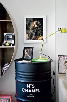 Great idea for the boutique! Spray paint a metal garbage can with chalkboard paint, stencil on a design or quote, turn it over and use as side table. Decorate with chalk!