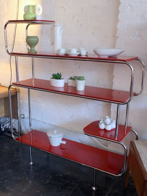 Awesome Mid Century etagerie. Even if I have no space for it I still want one of these, this is a style statement not just a shelf ;)
