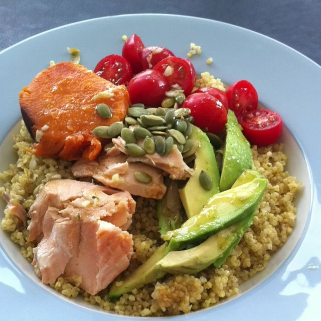 Wildrose cleanse food   baked salmon w/ lemon and herbs, slice of roasted sweet potato, cherry tomatoes, 1/2 avocado, raw pumpkin seeds on a bed of quinoa and millet. Dressing-olive oil, lemon, cumin, garlic,