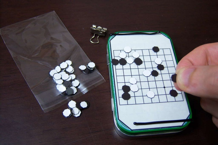 Travel board game set in an Altoids tin: GO, Othello, chess, checkers, shogi, Chinese checkers, backgammon, nine man's morris, twelve man's morris, cribbage, and farkel.