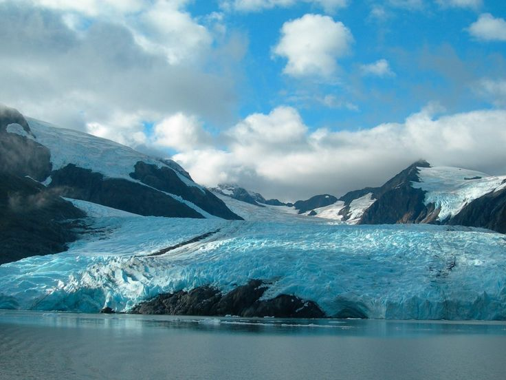 Experience Alaska's icy climate, even in the summer, by taking a cruise to Portage Glacier, just an hour from Anchorage.    #AnchorageAlaska #ThingsToSeeNearAnchorage  #GlaciersInAlaska  #AnchorageDayTrips