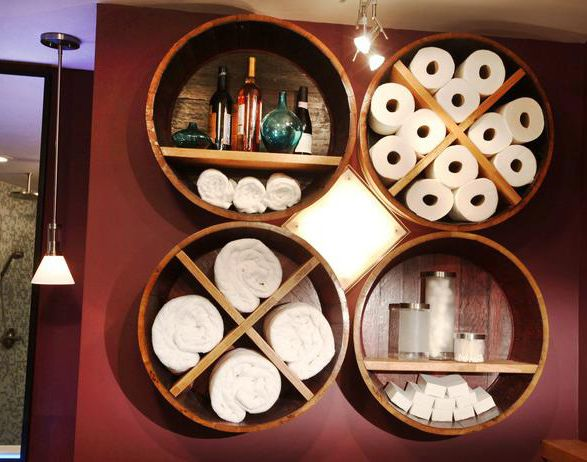 15 Creative DIY Bathroom Storage Solutions. These towel and toilet paper holders were made from a wine barrel!
