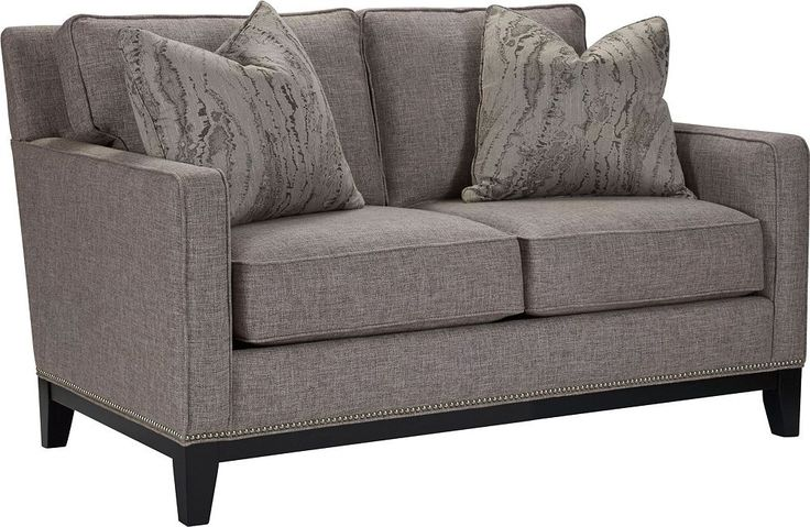 Markham Loveseat Crisp, clean. Not unlike a fine wine. The Markham Loveseat presents a traditional look. Track arms. Nailhead trim. Wood front and side rails. Tapered legs. Choose the Impressions fabric that suits your transitional décor. Invite friends over. Relax and repeat.
