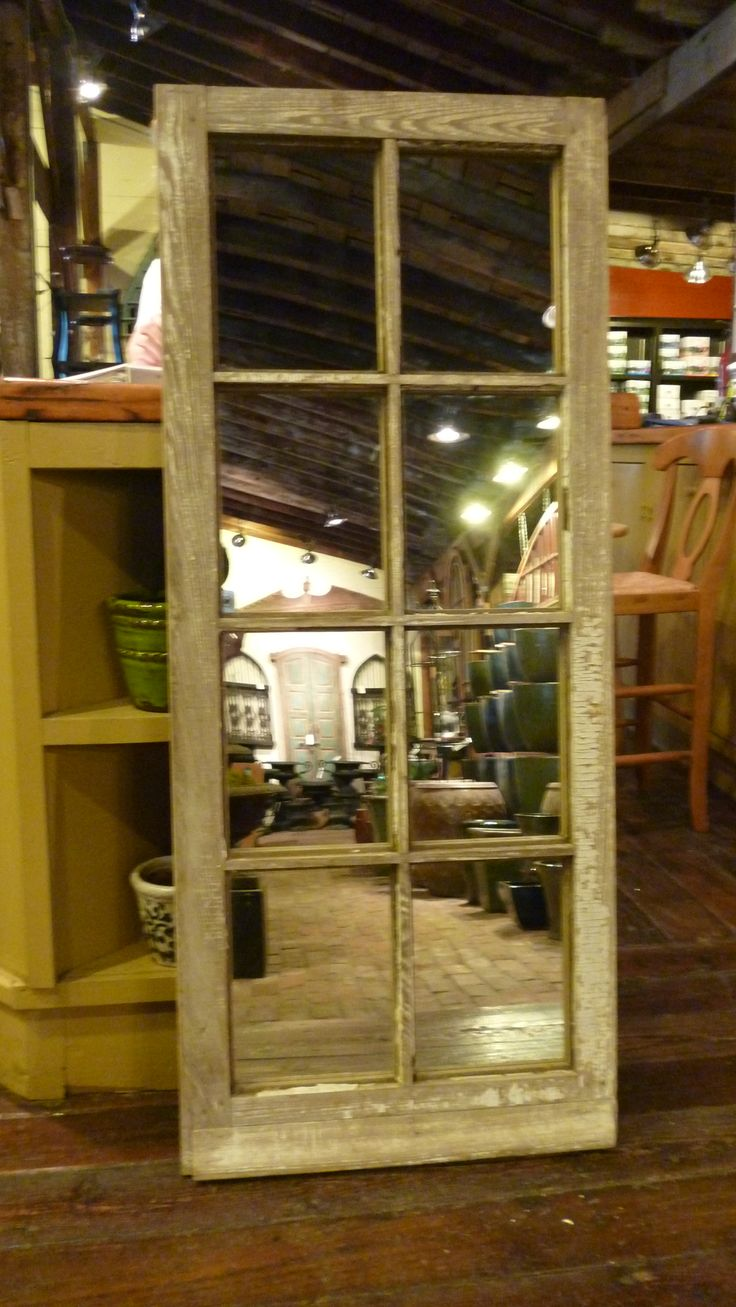 old window turned into a mirror. Craft stores have a spray paint that turns glass into mirror