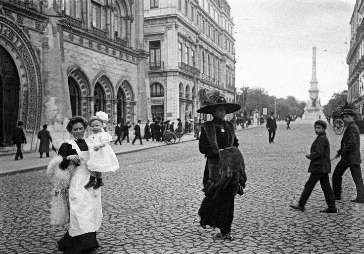 An elegant lady followed by her maid. Lisbon, 1912.   Photo by Joshua Benoliel.