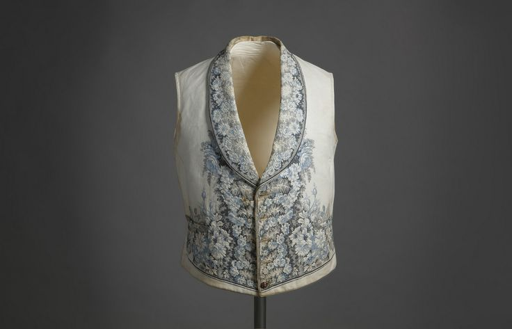 Vest. Ca. 1840. Cotton Pique white with floral embroidered motifs in blue (Costume Museum. CIPE) by Museo del Romanticismo
