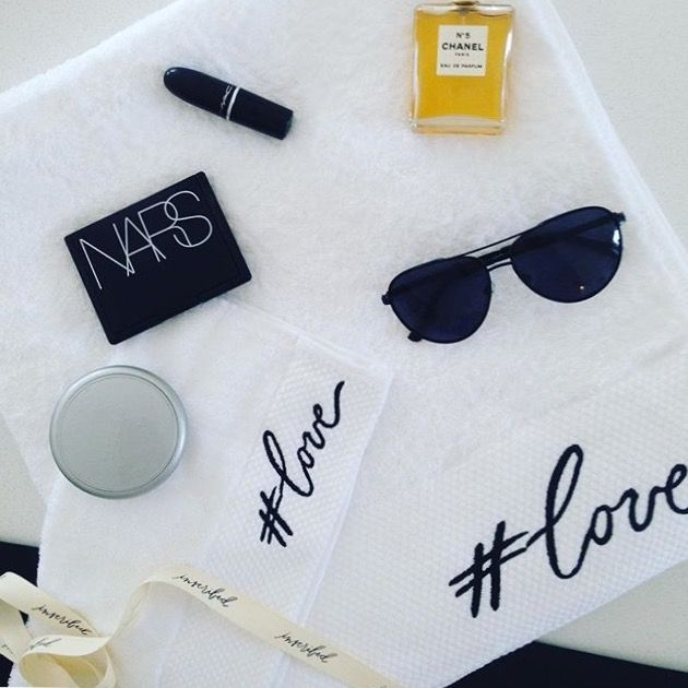 #love inscribed typography embroidered towel flatlay
