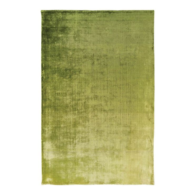 Designers Guild Eberson Grass Rug - Luxury ombre toned designer rug.The Eberson Grass Rug from Designers Guild is a high energy rug sure to refresh your interior.With its inviting tones of moss, lime and grass green, the Eberson rug works perfectly as a centre-piece in the lounge or hallway.The 100% luxury rayon is balanced in harmony as the sumptuous colours glisten and illuminate in a play of light.Hand-woven on a broad loom, the intensity of the rug is achieved by drying the yarns in the…