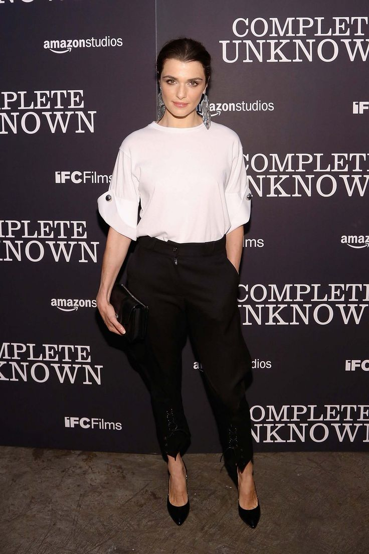 Rachel Weisz in Monse, Sophie Buhai earrings, Proenza Schouler bag, and Christian Louboutin shoes.
