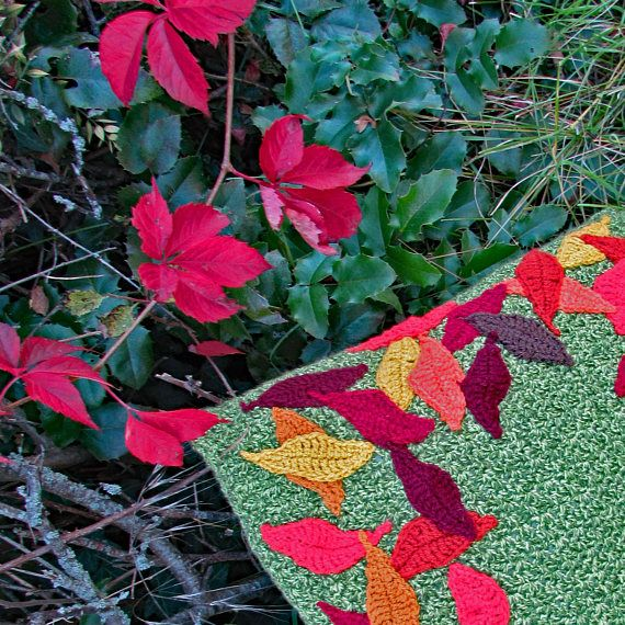 FALLING LEAVES CROCHET CUSHION PATTERN Crochet a beautiful cushion in rich autumnal colours that recreate the beauty of falling leaves. Perfect for using up those little scraps of yarn lingering in your stash. #crochet #cushions #pillows #crochetpattern #crochetpillow #crochetcushion #autumn #fall