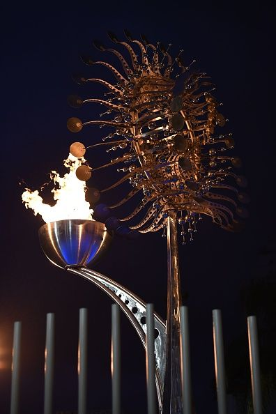 The Olympic flame is pictured outside the Candelaria Church on August 7 2016 during the Rio 2016 Olympic Games in Rio de Janeiro /…