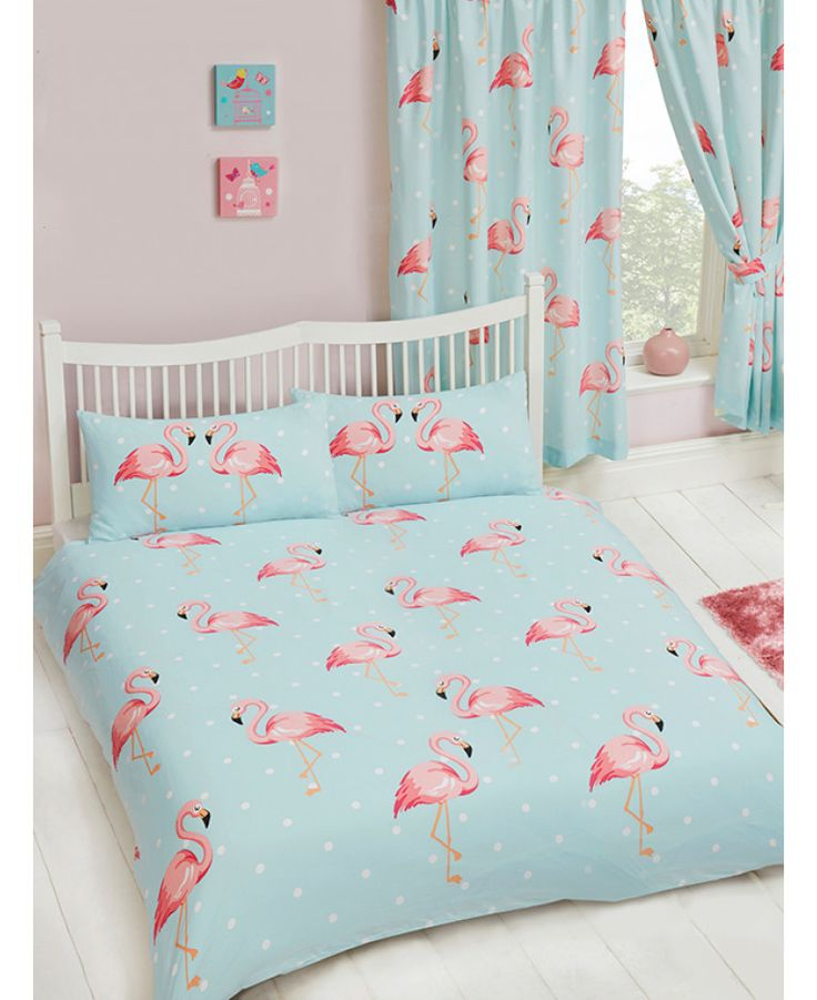 The Fifi Flamingo Double Duvet Cover and Pillowcase set features coral pink flamingos on a pale turquoise blue and white polka dot themed background. Free UK delivery.
