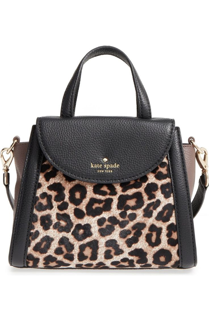 Go a little wild with this compact Kate Spade satchel fashioned from supple pebbled leather accented with leopard-print genuine calf hair.