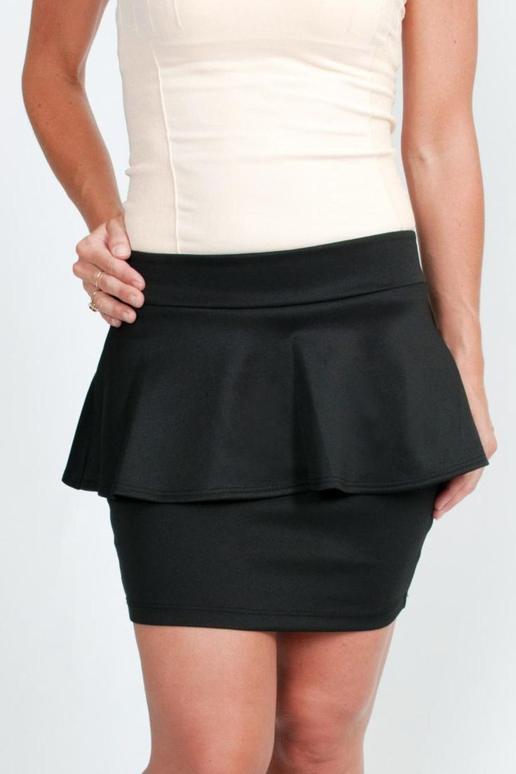 Black peplum skirt. This skirt looks great for the office or dress up for a night out! Just pair with a blouse or a halter top!   Black Peplum Skirt Clothing - Skirts Massachusetts