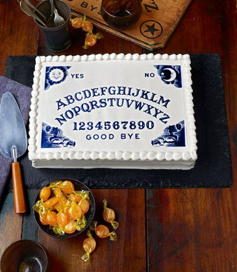 """Channeling this professional-looking cake is much simpler than it appears. Just download our free Ouija-board art (courtesy of Hasbro Inc.), then upload it to cakeart.us. The folks there will turn it into an 8""""W x 10""""L sheet of edible wafer paper—for just $4.75."""