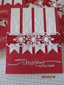 Lovely snowflake embossed white banners on red cardstock ...