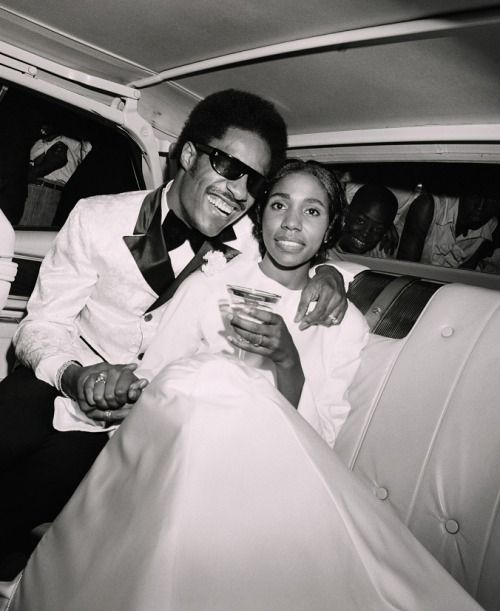 "Stevie Wonder and his first wife, the brilliant singer and songwriter Syreeta Wright (1946-2004) as they celebrate their wedding day on Sept 12, 1970. Ms. Wright co-wrote ""Signed, Sealed, Delivered, I'm Yours"" and ""If You Really Loved Me"" with Mr. Wonder and recorded ""With You, I'm Born Again"" with Billy Preston in 1979. The newlyweds are seen as they leave Bernette Baptist Church in Detroit en route to their reception. They honeymooned in Bermuda."