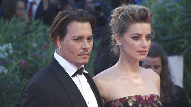 Johnny Depp and wife Amber Heard walk the red carpet at the Venice Film Festival.