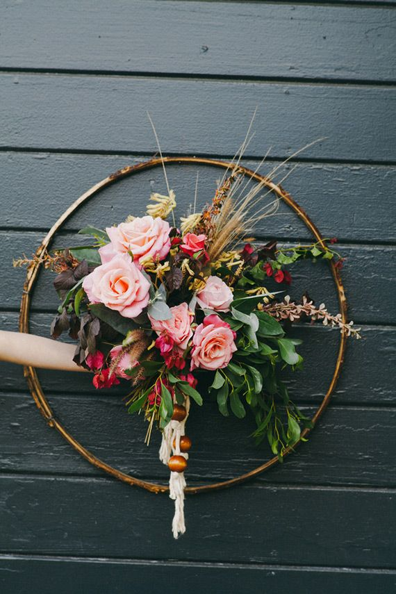 Big wooden beads knotted on dangling ivory cord give this loose, lush bouquet a laid-back '70s vibe.