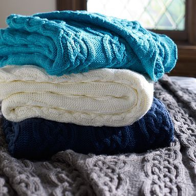 I like the Cozy Cable Knit Throw. Pbteen. The navy to layer over a white duvet or white to layer over a navy duvet.