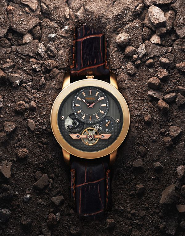 Fossil by Justin Sicard I like this shot because it highlights the title with the dirt ground and the lighting gives the watch nice tones.