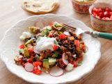 Ree Drummond is cooking against the clock to make four of her favorite recipes over into lighter, healthier 16-minute meals. There's Lighter Chicken Parmesan for a quick kids' dinner, then Lighter Asian Noodle Salad is a perfect speedy lunch for when Ree's up against it. Next, she's transforming her tasty Taco Skillet, a wonderful help-yourself meal. Finally, Lighter Fried Pork Chops, served with super fast white beans and spinach, is perfect for dinner.