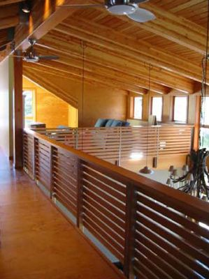 Cascade foothills - CDX fir plywood interior walls and floors - fir and steel slat railings - antler chandelier