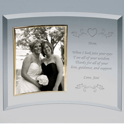his personalized glass picture frame is engraved with a beautiful heart vine design on the top