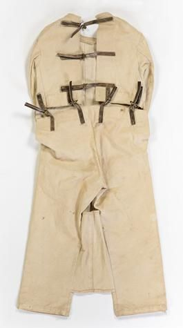 Straitjacket with Webbed Trousers - Cream Canvas, circa 1900. Used to restrain patients in a mental health hospital in Victoria Austalia.