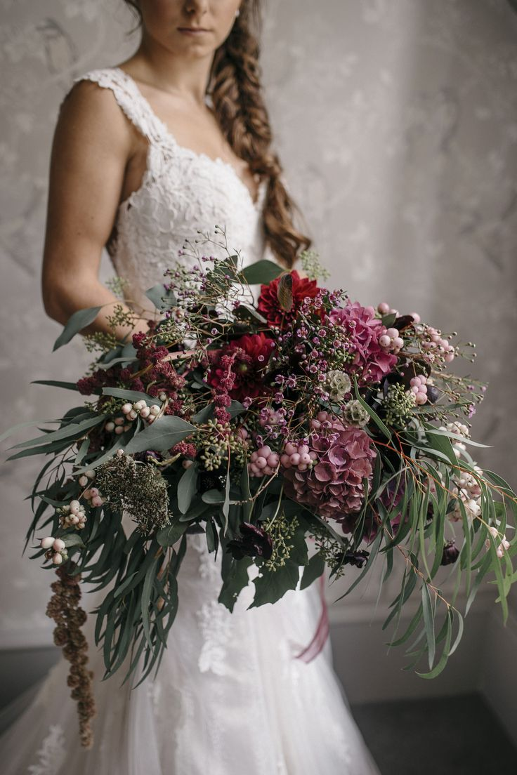 Asymmetrical over sized bouquet featuring lots and lots of greenery, foliage, eucalyptus, hydrangea in muted dusky pink and purple. Captured by Shelley Richmond Photography