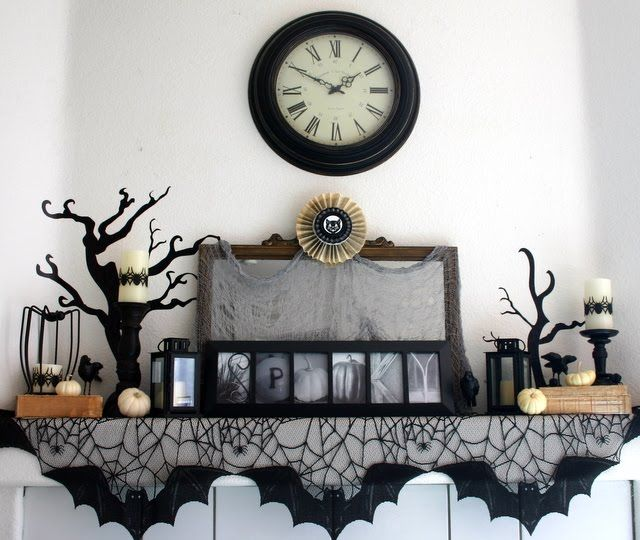 Spooky Mantel- love the spiderweb runner and the way the bats are positioned along the edge