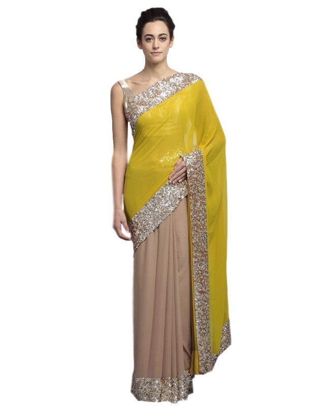 This party wear saree is in fawn colour in high quality gorgette fabric. It has yellow colour gorgette pallu. Blouse of this party wear saree is also fully embroidered with sequin handwork like border