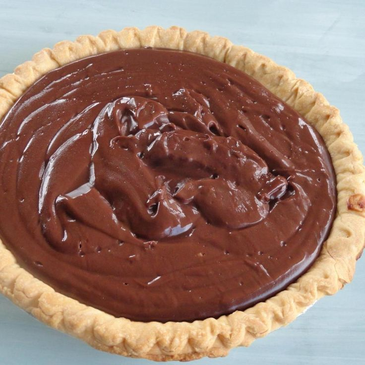 "I know some of you say, ""OH NO NOT FROM SCRATCH"", But believe me, Nothing compares, to Scratch taste. This pudding is such an easy recipe, You'll wonder why you ever buy a box. This Chocolate Pudding is So creamy and is my all time favorite. Top this Pie with Sweetened Whipped Cream and you have one delicious Pie. My Mom says its from a box of Hersheys Cocoa, I have No clue, But it has been a family favorite for a very long time."